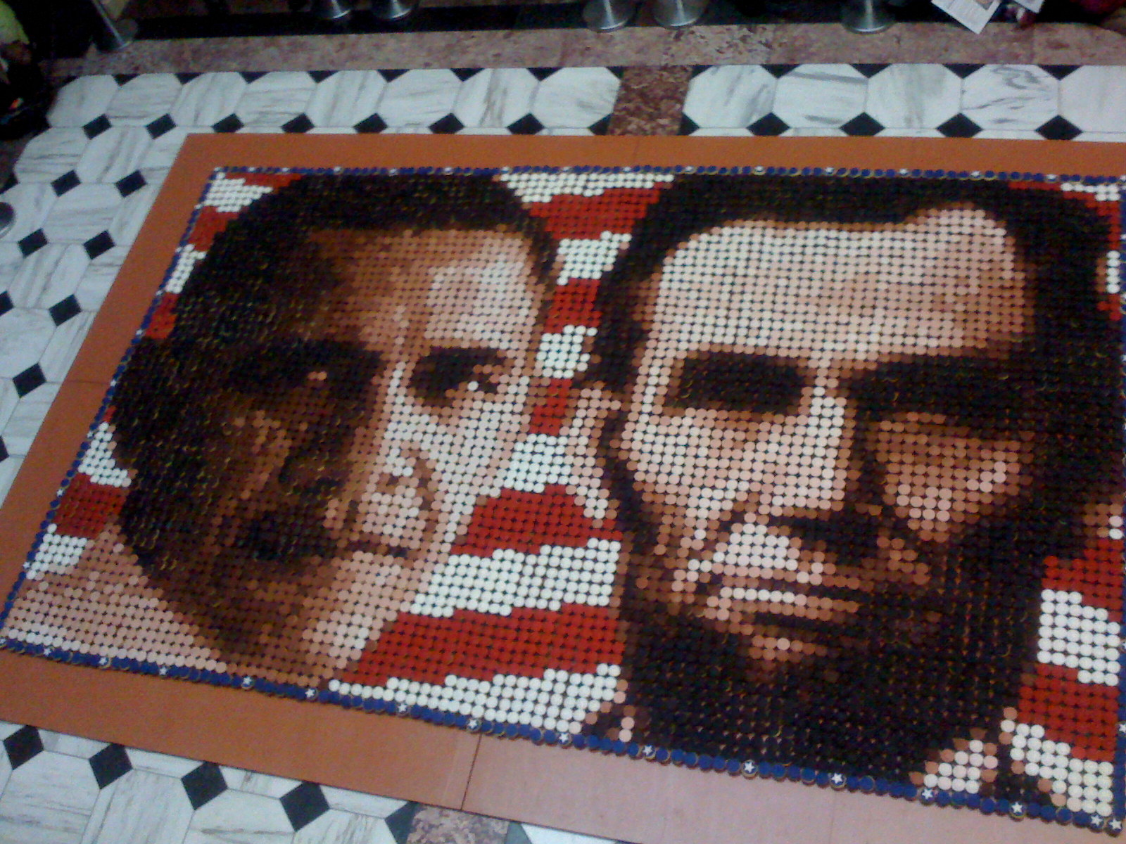Portraits of Obama and Lincoln, in cupcakes