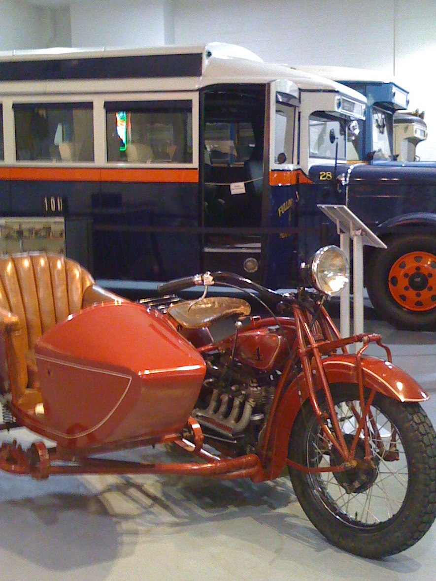 Motorcycles and buses at the Antique Automobile Museum of America Museum