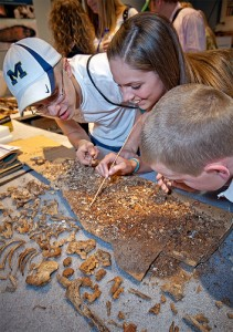 Kids playing at the Natural History Museum's Fossil Lab