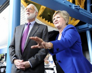 Dr. G. Wayne Clough, Secretary of the Smithsonian, and Dr. Deborah Barnhart, CEO of the U.S. Space & Rocket Center, walk under the Saturn V at the U.S. Space and Rocket Center Friday, Dec. 14, 2012 in Huntsville, Ala. (Eric Schultz / eschultz@al.com)