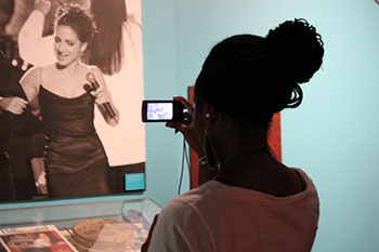 Student using mobile technology in an exhibit.