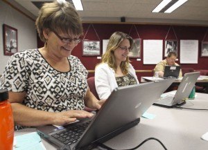 (left to right) Deb Smith, an English teacher at Lyman High School in Presho, and Alyssa Anderson, a 7th grade language arts and 8th grade journalism teacher in Chamberlain, work on their mission plans for the upcoming school year. Allison Jarrell/Capital Journal
