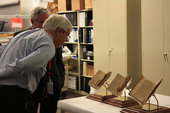Ed Nichols, History Colorado director, and Harold Closter, Smithsonian Affiliations director view Jefferson's Bible before it is displayed at History Colorado (Denver).