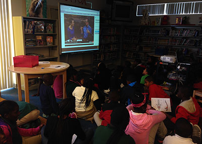 Students watching the Q?RIUS webcast from the National Museum of Natural History in Washington, D.C. Photo courtesy Frost Museum of Science.