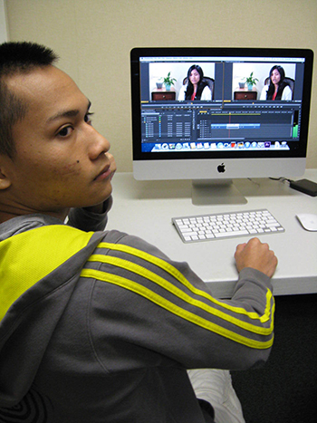 Students help edit each other's interviews using Mac OS Editing Software