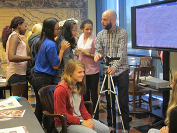 Shoulder to Shoulder-- Oklahoman students eager to learn the film making processes of oral histries in a workshop led by Moving Image Archivist, Corey Ayers