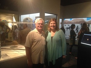 Michael Hammond, Director of Agua Caliente Cultural Museum and Sarah Mundy, Director of Riverside Metropolitan Museum in front of the display case holding the artifacts on loan from the National Museum of the American Indian.