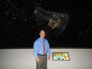 Richard Allen, Chief Executive Officer, Space Center Houston, in front of Mercury Space Capsule on loan from the National Air and Space Museum.