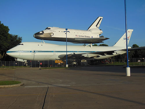 Space shuttle replica atop a NASA shuttle carrier