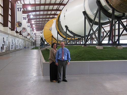 Richard Allen and Meg Naumann, Director of Development, in front of the Saturn V rocket, also on loan from NASM.