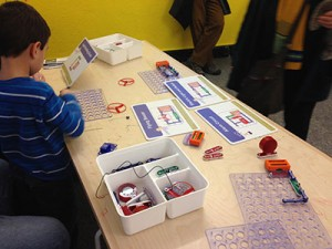 "Henry Woodward tries his hand at ""Snap Circuits"" Photo by Jim Levulis WAMC"