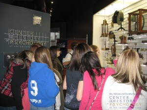 High school students on a field trip to CCHP marvel at the artifacts on view.