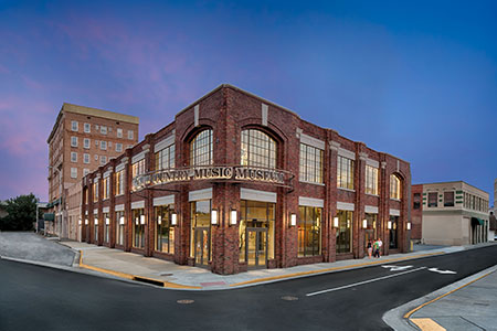 The Birthplace of Country Music Museum at night. Photograph by Fresh Air Photo