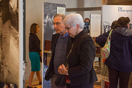 Visitors enjoy the New Harmonies exhibit on its opening night at BCMM, March 2015. Photograph by Haley Hensley, Birthplace of Country Music Museum