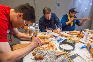 UAA students work on cedar whistles at the Anchorage Museum's Smithsonian Arctic Studies Center.