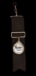 The John Clum watch fob which tells the story of the gold rush in Alaska, on loan from the National Postal Museum, will be on view at MoAF in November.