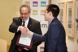 Harold Closter (left), director of Smithsonian Affiliations, and David Schmitz, executive director of the Dubuque Museum of Art, mark the local museum's designation as a Smithsonian affiliate.