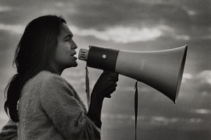 Dolores Huerta with bullhorn by Jon Lewis, gelatin silver print, 1965. ©Yale Collection of Western Americana, Beinecke Rare Books & Manuscript Library