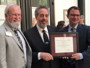 Mercer Museum and Fonthill Castle President and Executive Director Douglas Dolan; Director of Smithsonian Affiliations Harold Closter and Mercer Museum and Fonthill Castle Board of Trustees Chair John Augenblick show off the certificate that states the museum and the castle are now Smithsonian Institution Affiliates during a gathering at the Mercer Museum in Doylestown on Thursday, May 19, 2016. Photo by Christian Menno, Staff