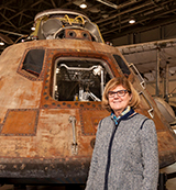 Myriam Springuel in front of Apollo capsule