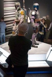 visitors filter through Star Wars Costume Exhibit at the Denver Art Museum