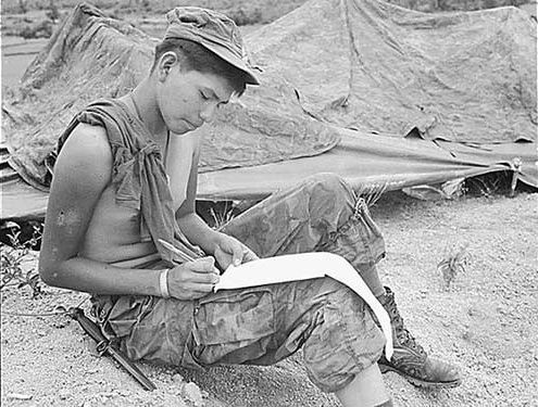 A soldier in Vietnam writes a letter.