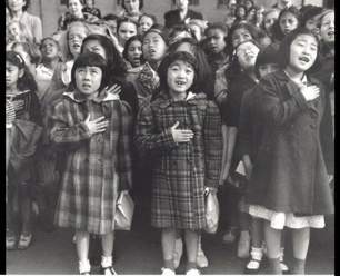 School girls reciting the pledge of allegiance