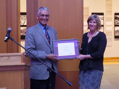 Kevin Gover and Julie Decker pose with certificate of affiliation