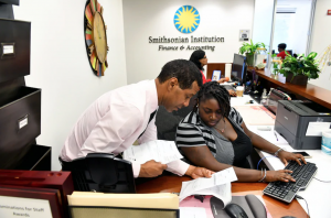 An intern works with her supervisor at the Smithsonian
