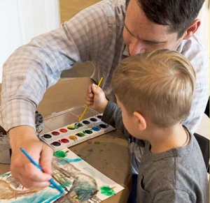 man and child painting