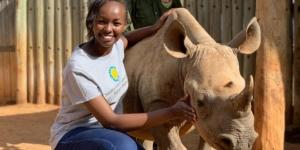 Smithsonian researcher with a rhinoceros