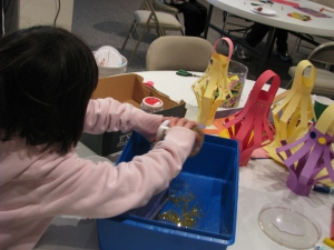 A child makes Chinese lanterns from art supplies.