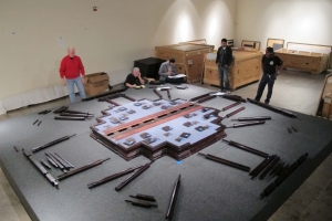 Pieces of the Ten Thousand Springs Pavilion are laid out on the floor prior to assembly.