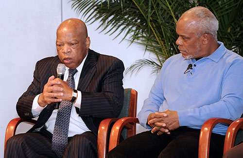 The late John Lewis seated next to filmmaker Stanley Nelson on stage at the National Youth Summit