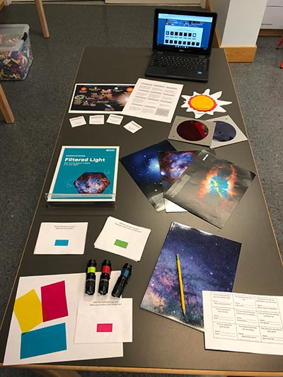 Astronomy resources are placed on a table at the Anchorage Museum